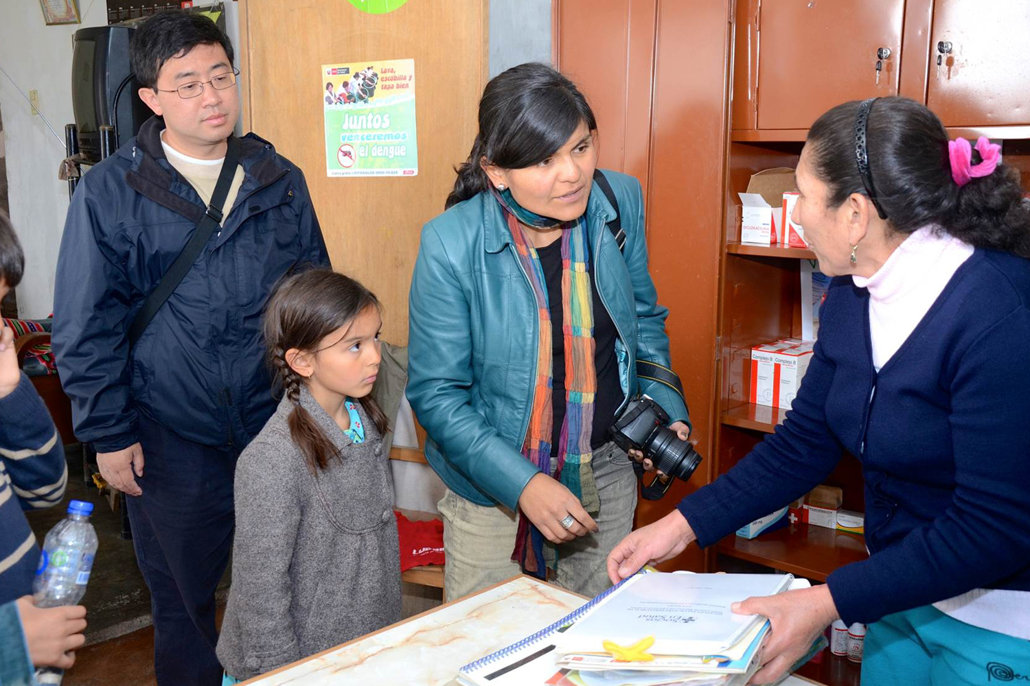 Assoc. Profs. Benyuan Liu and Maria Julia Brunette talk to a health-care worker at a TB clinic in Carabayllo, near Lima, Peru, during their visit in August 2013.