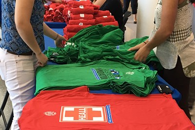 RAs at UMass Lowell get ready to distribute t-shirts on move-in day for the living-learning communities