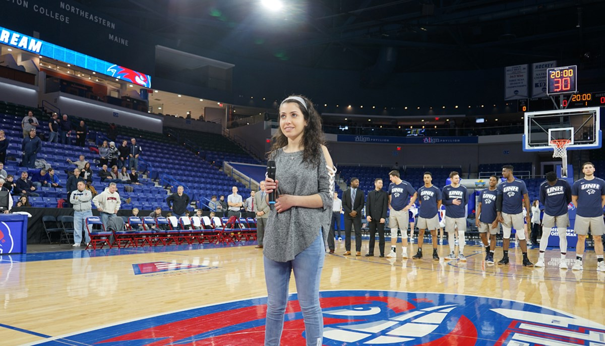 Nicole Hayek sings the national anthem before the UMass Lowell men's basketball game on Martin Luther King Jr. Day at the Tsongas Center