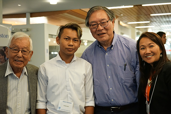 Incoming student Kennis Mor with, on left, Nisei Student Relocation Commemorative Fund board member Yutaka Kobayashi, UMass Boston Prof. Paul Watanabe, the board's president, and UML Assoc. Prof. Phitsamay Uy.