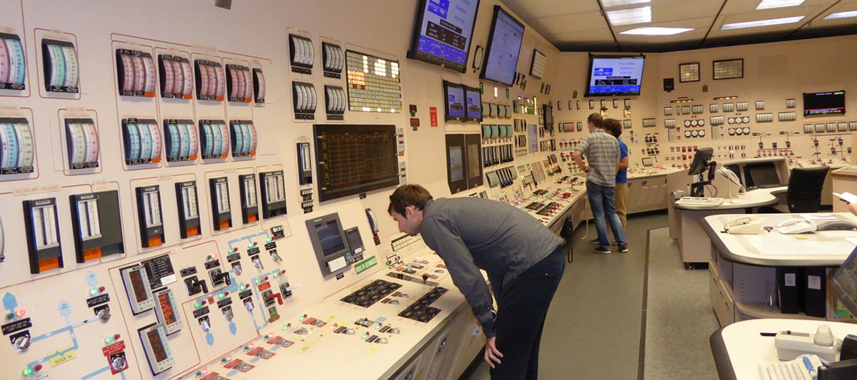 Chemical/Nuclear Engineering students working in the control room of the nuclear reactor.