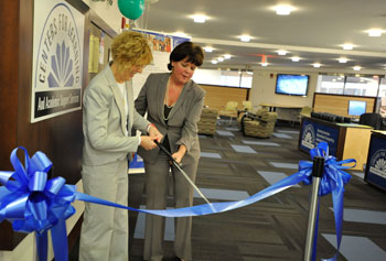 Retired Library Director Pat Noreau, left, who oversaw the transformation of O'Leary Library into the O'Leary Commons, and Sheila Riley-Callahan, executive director of academic services and special programs, cut the ribbon to officially open the facility.