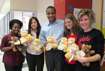 From left, Pascale Jean-Jacques, Connie Cabello and David Jones donated teddy bears made by UMass Lowell students during MLK Week to local organizations including representatives from Girls Inc. of Greater Lowell, right.