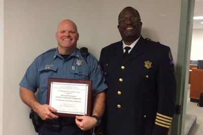 Officer Emmons with Chief Brashears