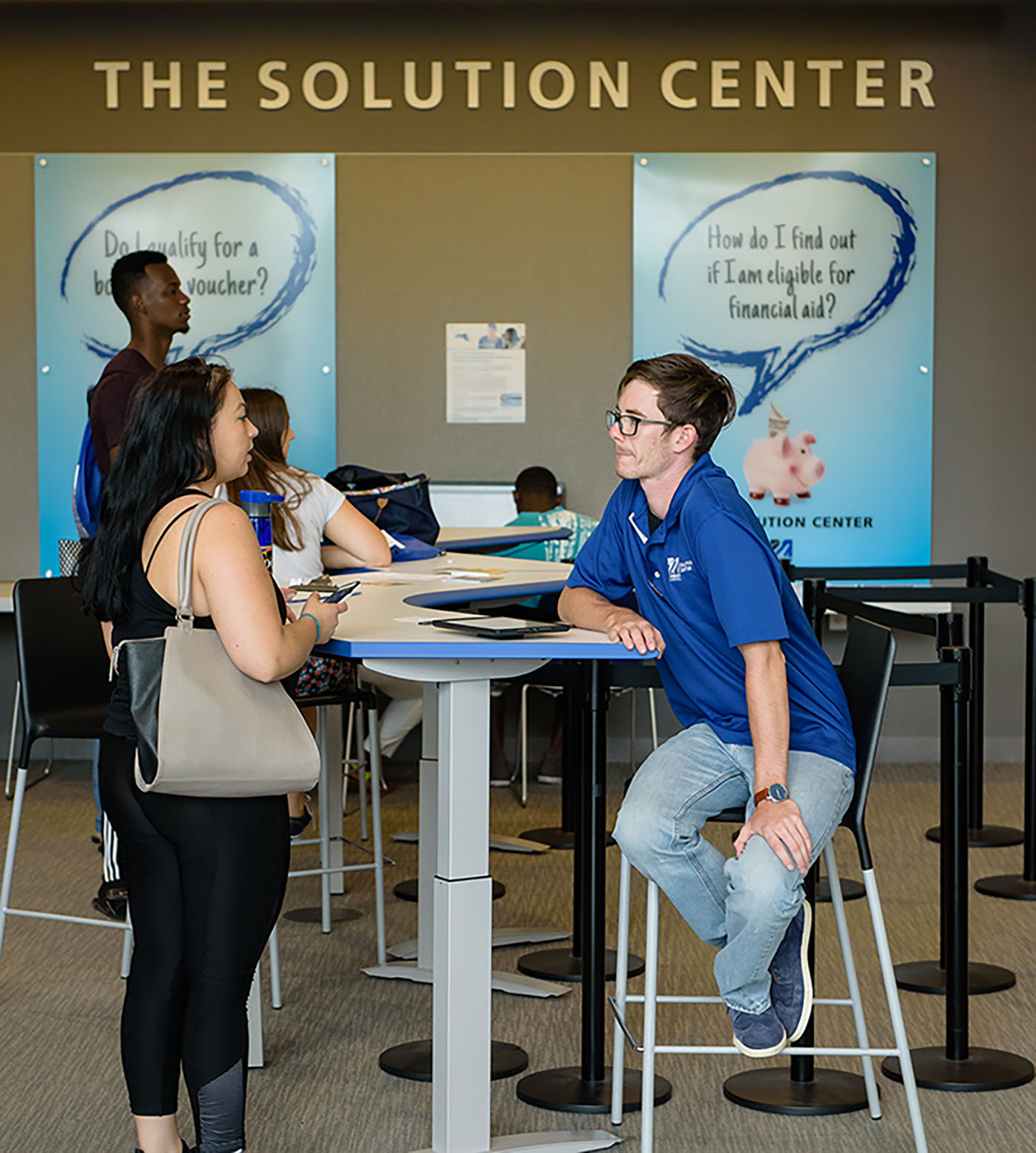 solution center student worker assisting students with quesitons