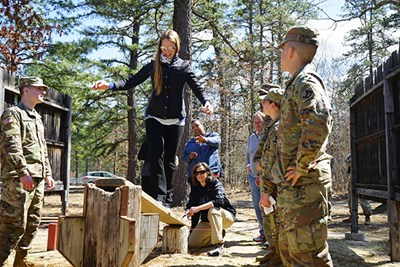 Holly Butler crosses a bridge on the leadership reaction course