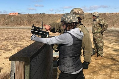Kim Merriman learns how to fire a grenade launcher