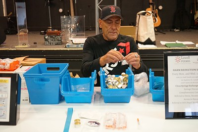 Joe Faria, an outreach worker who also helps with the needle exchange program, prepares safe injection supplies at the Life Connection Center