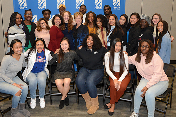 Chancellor Jacquie Moloney poses with two dozen Oprah Winfrey Scholars who have been helped by the scholarships her visit created.
