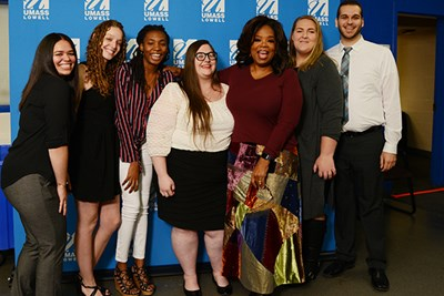 Oprah Winfrey with the first six students awarded scholarships in her name.