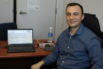 Assist. Prof. Asil Oztekin at desk