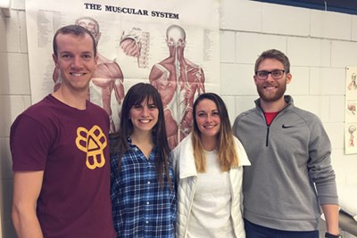 PT students Luke Harmeling, Jennie Pisarik, Casey McNamara and Josh Kilmonis pictured in a classroom at the Rogers School in Lowell