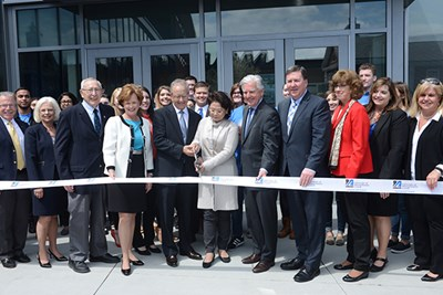 John Pulichino and Joy Tong cut the ribbon on the Pulichino Tong Business Center