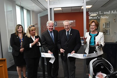 Stuart Mandell cuts the ribbon on the Dean's Suite