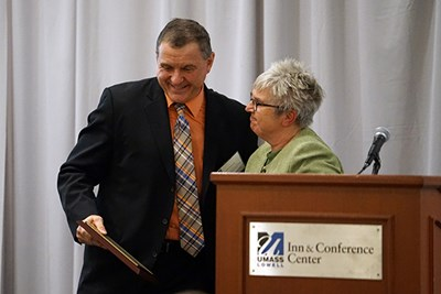 John Doherty receives an alumni award from Anita Greenwood