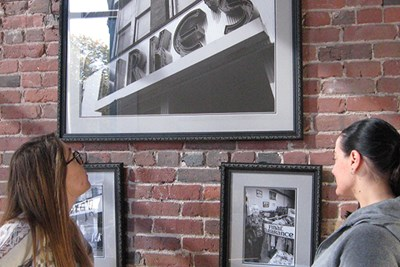 Autumn and Suzanne look at historical photos of Birke's in the former Birke's building