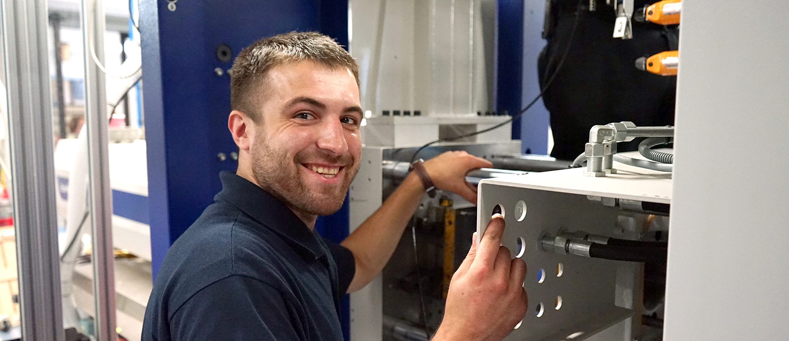 UMass Lowell Plastics Engineering student Patrick McCallum interns at Wittmann Battenfeld
