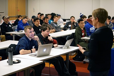 Students listen to iRobot's Lisa Freed speak