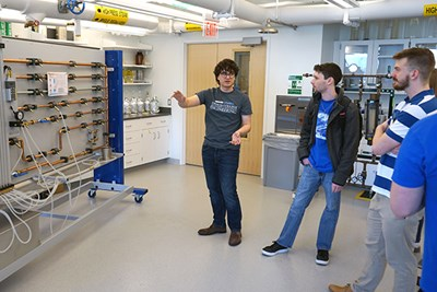 PhD student Eddie Fratto gives a tour of a teaching lab