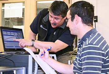 Prof. Peter Avitabile, left, works with a student in his lab.