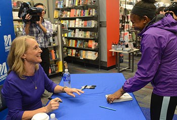 Piper Kerman signs her book at UMass Lowell's River Hawk Shop/Photo by Tory  Germann