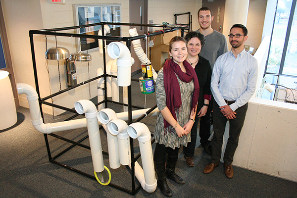 The research team of, from left, senior Martha Robertson, Asst. Prof. Elissa Johnson-Green, senior Tyler McMillan and visiting lecturer Christopher Lee have set up two EcoSonic Playground prototypes at Durgin Hall.