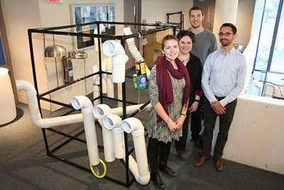 Students and faculty pose with an EcoSonic Playground prototype