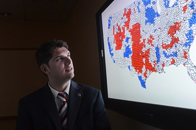 Assoc. Prof. Josh Dyck looks at a polling map