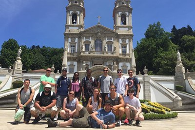Students pose in front of Bom Jesus do Monte, a religious sanctuary overlooking Braga.