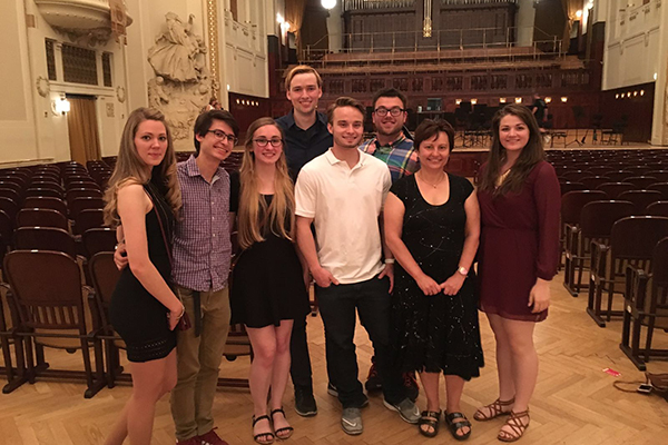Assoc. Prof. Jana Sladkova, second from right, and her students visit historic Smetana Hall during their 'Summer School of Migration in Prague' study-abroad course in the Czech Republic.
