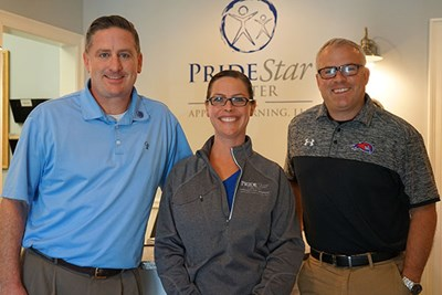 Frank McCabe, Alissa Rahilly '02, '12 and David Daly of PrideStar Center for Applied Learning