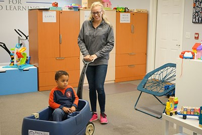 Alexis Kitsakos '15 gives a child a break from learning tasks.