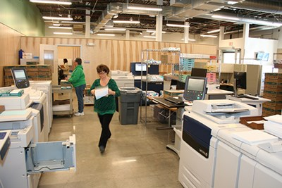 Print center staff members work in new facility