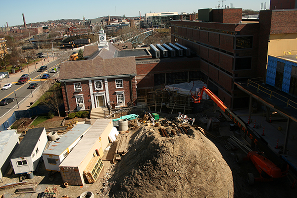 Work continues through the summer on the Pulichino Tong Business Center, which offers a view of Lowell over Alumni Hall and Lydon Library.