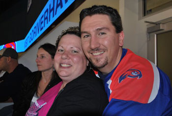 Danielle and Caleb Hand held their wedding rehearsal dinner at a River Hawks hockey game, just one of many strong connections between the family and team.