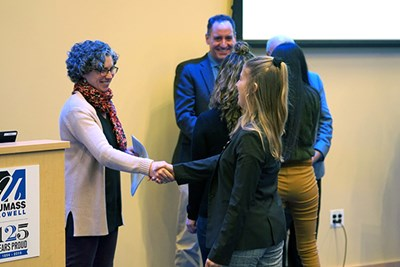 Juliette Rooney-Varga shakes hands with student Brittany Segill
