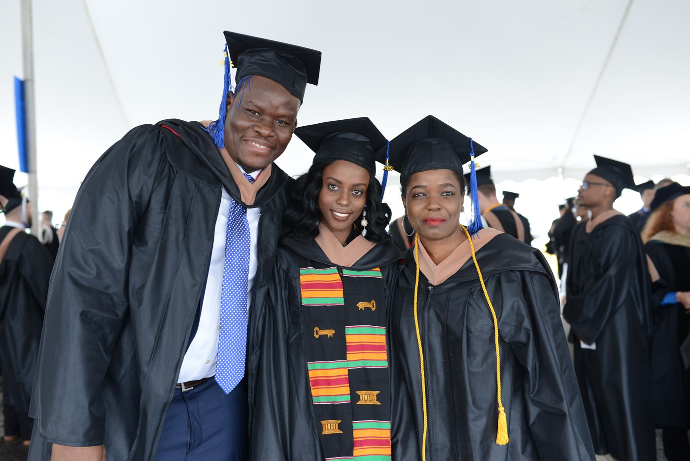 female graduating student posing with family at 2018 Commencement ceremonies.