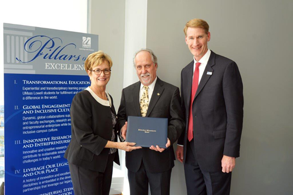 Chancellor Jacquie Moloney and Joseph Hartman, provost and vice chancellor for academic affairs, congratulate William Moylan, center, on becoming UMass Lowell's 12th University Professor.