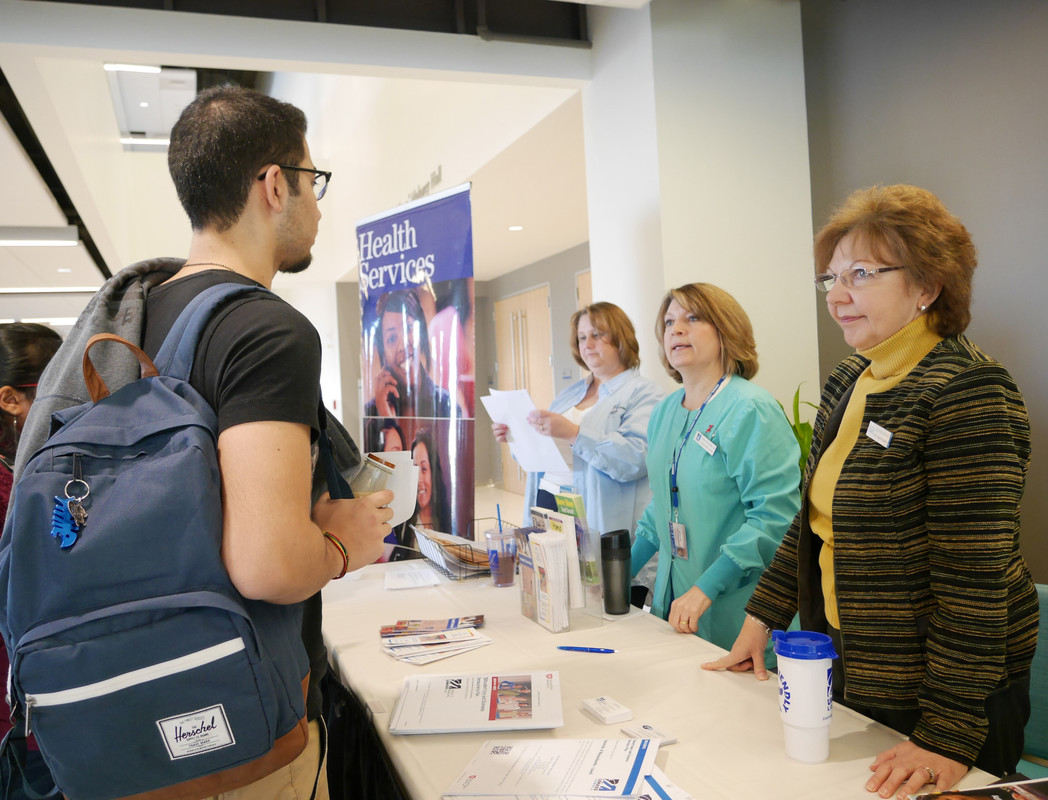 Students talk to representatives from Health Services at the International Student Resource Fair