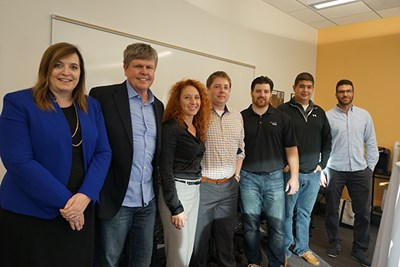 Sandy Richtermeyer, Chris MacKenzie, Stephanie Tate pose with alumni working at RSM