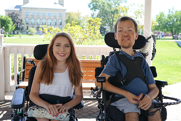 Siblings Elizabeth and Nick Raymond share a genetic condition, spinal muscular atrophy, that requires them to use wheelchairs but that's where the similarity ends.
