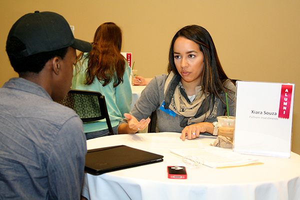 Putnam Investment's Xiara Souza, a Manning School alum, advises a student during the Drop-in Résumé Makeover session at University Crossing.