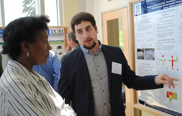 Mechanical engineering master's student Richard Poillucci discusses research of safer alternatives to styrene with Donna Staker of Tetra Tech.