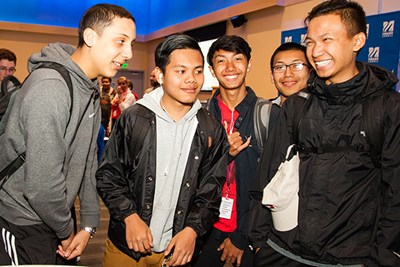 Rifat Islam (left) jokes with his friends at the final service learning celebration.