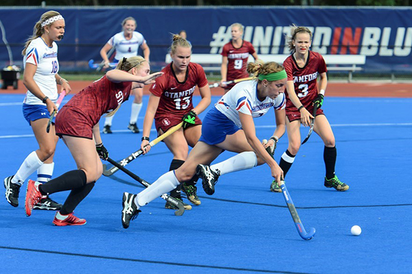 The River Hawk field hockey team battles Stanford earlier this season on the Wicked Blue turf.
