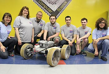 Members of the 2013 Rover Hawks include, from left, Brigit Schroeder, Prof. Holly Yanco, James Dalphond, Eric McCann and undergraduate students Alejandro Salido, Adam DeFelice and Carlos Ibarra.