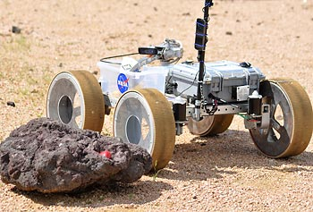 The rover designed and built by the UMass Lowell Rover Hawks navigates a Mars-like terrain at NASA's Johnson Space Center in Houston.
