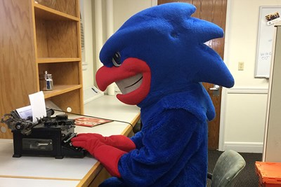 Rowdy the River Hawk gets help on his final paper at The Writing Center.