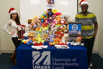 Student Alumni Ambassadors Catherine York and Ralph Saint Louis collect stuffed animals as part of the fourth annual Rowdy Cares with Bears drive.