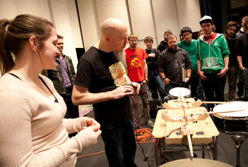 Jordan Rudess plays Alisha LeBlanc's, left, Drumbot, a drum machine controlled by a video game controller she designed in the contemporary electronic ensemble with visiting Asst. Prof. Mike Testa, center background.
